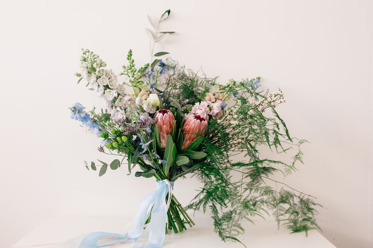 Pastel bridal bouquet featuring protea and ferns. Photography by Danni Maytree Photography