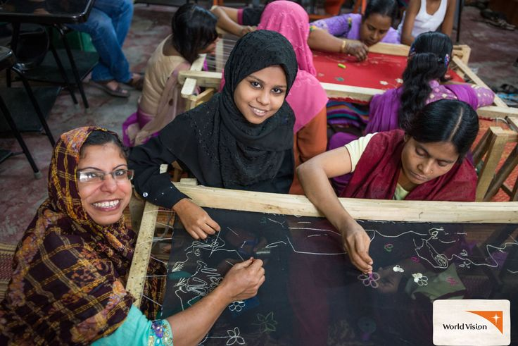 """Akhi sits with her mother Jesmin as she learns """"#karchupi"""" #embroidery at a centre in #Bangladesh. With support from #Childsponsorship Akhi is thriving at school and wants to be a teacher – but she still attends #WorldVision centres to learn other useful skills! Photo by Jon Warren, World Vision"""