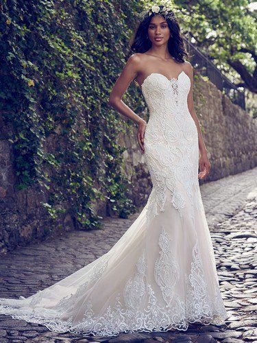 Maggie Sottero NOVIAS - AUTUMN, Beaded lace motifs cascade over tulle in this fit-and-flare wedding dress, accenting the illusion plunging-sweetheart neckline and illusion scoop back. Lined with shapewear for a figure-flattering fit. Finished with covered buttons over zipper closure.