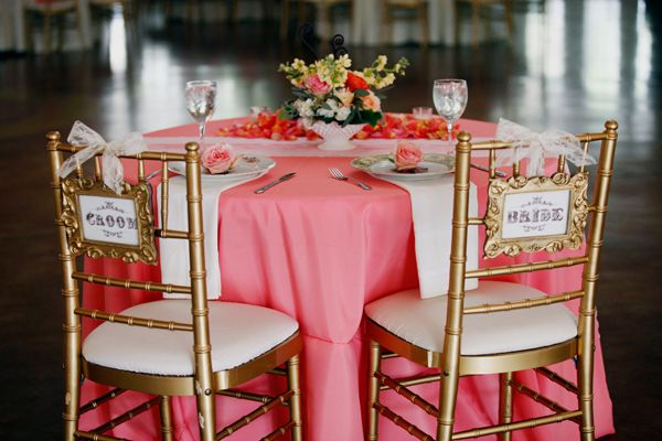 Coral linen and gold chairs.