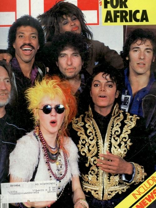 """USA for Africa - """"We Are The World"""", musicians and actors got together and recorded a song to raise money after the success of Band Aid in England."""