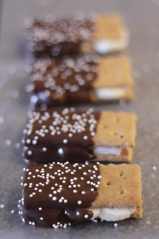 Dipped s'mores- graham crackers with 'fluff' in the middle. Dipped in chocolate. Perfect for parties.