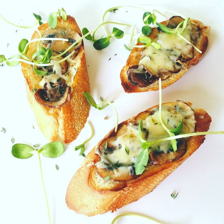 Today's after school snack, Pan-seared garlicky mushrooms and cheese on a slice of baguette with a dash of microgreens. Never throwaway old bread:)
