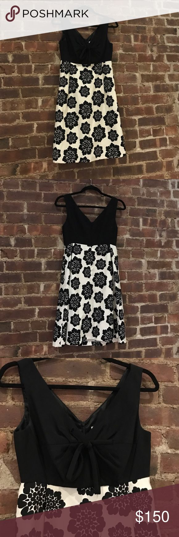 Milly black and white/cream cocktail dress size 2 Milly black and white/cream floral cocktail dress with a bow on the bust and POCKETS!  Size 2. Tons of life left! Classy dress for any occasion from work parties to weddings! Milly Dresses Mini