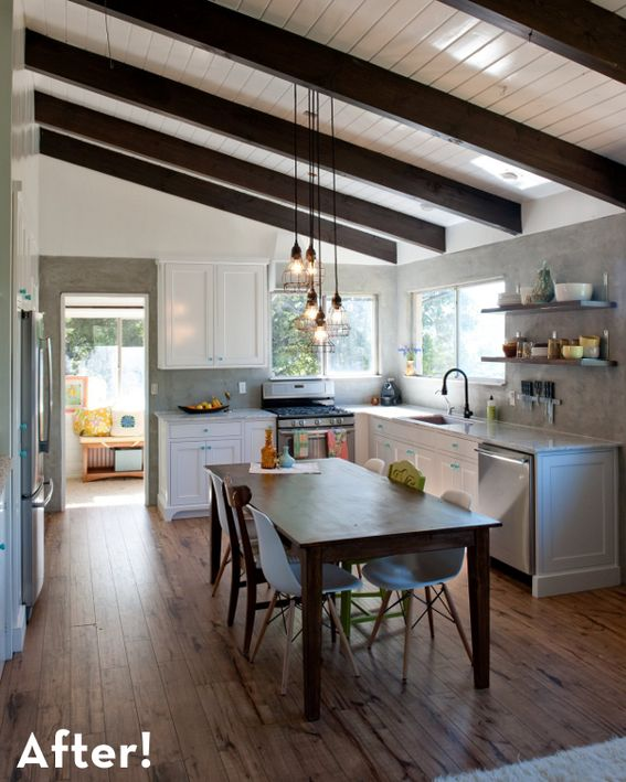Rustic modern kitchen remodel.  Love the exposed beams, the lighting, the balance of rougher, older, more handmade feel with sort of retro modern pieces with clean lines. Also the balance of light and dark is beautiful.