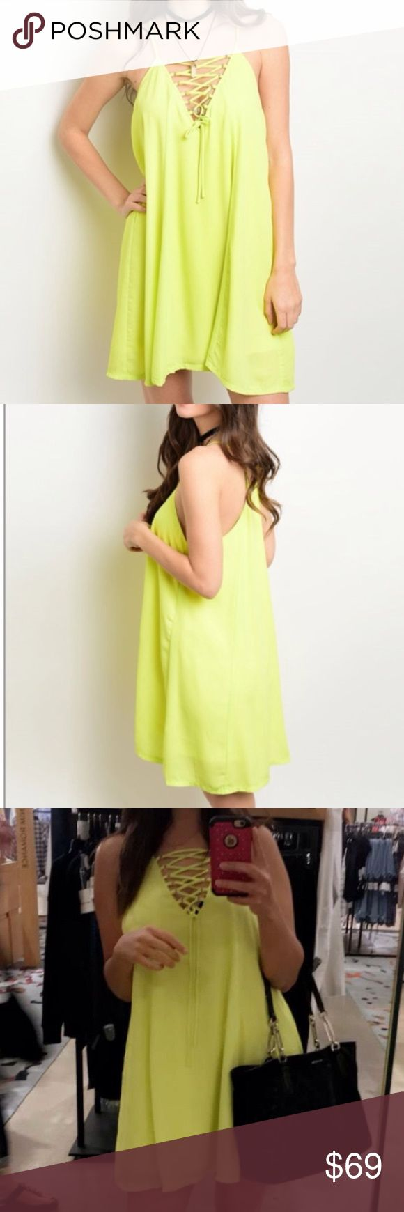 Neon Yellow Lace Up Dress Be bold in this bright yellow dress from WILA.  Trendy lace up caged style with racerback is perfect for Spring/Summer.  Looks great paired with black or nude wedges/sandals.  Dress is lined. Polyester. Items usually ship same or next day.  Boutique prices are firm. Bundle to save. MSRP $75. WILA Dresses
