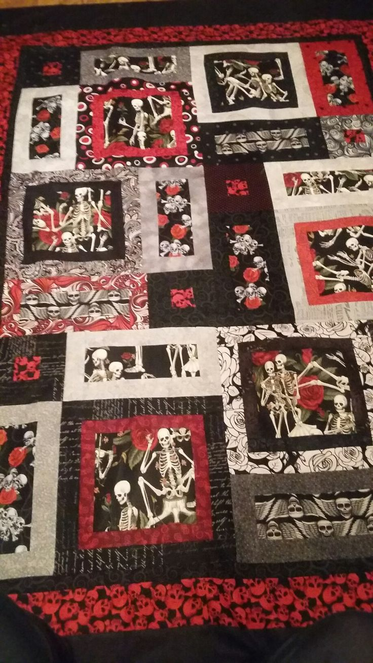 love love this one! red and black skull skeleton quilt made with Alexander Henry fabric