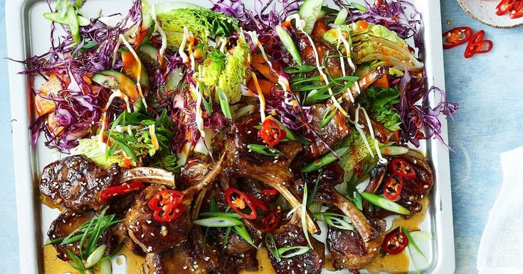 Tuck into these sticky lamb cutlets served with lettuce, cucumber, carrot and cabbage.
