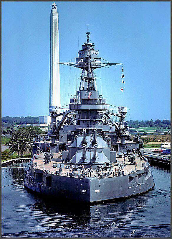 USS Texas with the San Jacinto monument in the background.