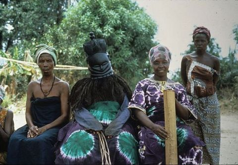 Rites of Passage are rituals held by the community that give value and meaning to life achievements to indiviuals.  This photo shows women prepared for the coming of age rite of a young woman of the Sande tribe.
