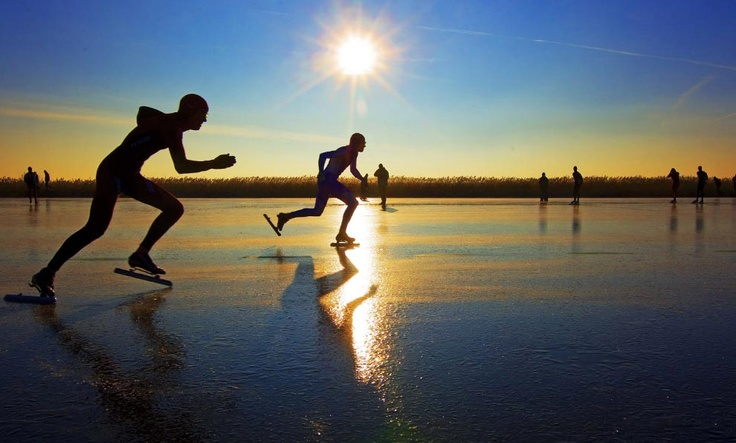 Skaters compete on a track of ice created from grassland sprayed with water, in the northern Dutch province of Frieslands on December 29, 2008.