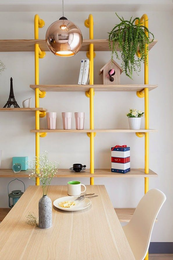 yellow tube bookshelf | Colorful modern apartment | Joyful Apartment by House Design Studio