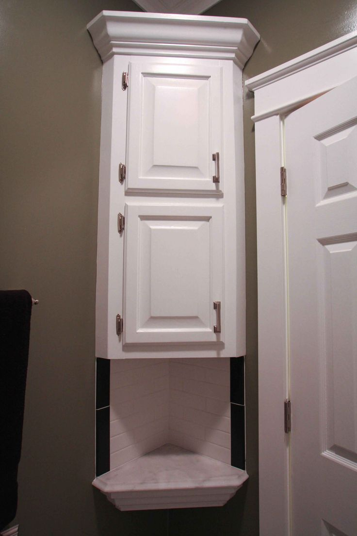 White Wooden Corner Floating Bathroom Cabinet With Double Doors And Rack On  The Wallpleting The Bathroom By Applying Exciting Above The Toilet  Bathroom