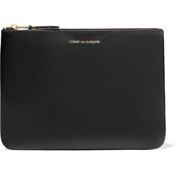 Comme des Garçons Leather pouch (€93) ❤ liked on Polyvore featuring bags, handbags, clutches, black, leather zip tote, leather handbags, leather zip pouch, zipper pouch and leather clutches