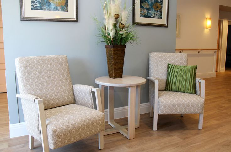 The solid timber Lexie armchair with arm pad matched with the timber cousins coffee table look great in this foyer.