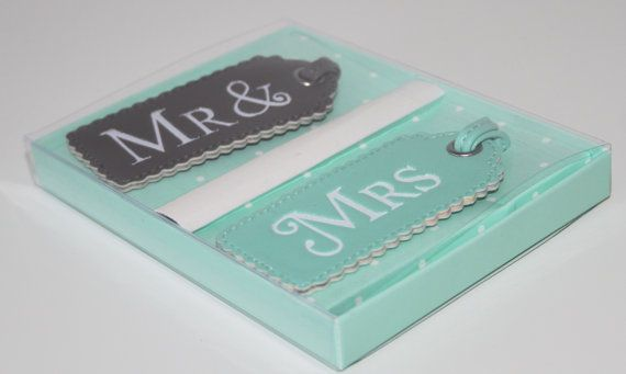 Mr & Mrs Luggage Tags  Lovely His & Her Wedding or Bridal Shower Gift. Perfect Honeymoon Accessory for newly Weds - Grey Luggage tag reads MR & - Teal Luggage tag reads MRS - Text is embossed in White - In a lovely gift box - Luggage Tags are made from a soft PU leather - Good quality – lovely Keepsake - Luggage Tag size 9cm x 4cm - Perfect finishing touch to any gift/favour - UK Seller - Postage to UK, Europe, USA and Canada. For postage outside please allow 5 to 7 days delivery   Thank you…