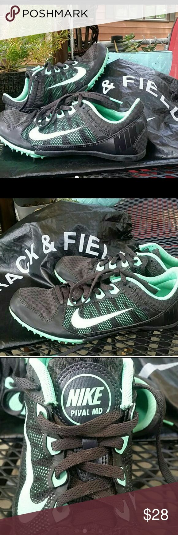 Womens Nike track and field spikes 7.5 Womens Nike track and field shoes in size 7.5.  In a aqua and black.  Great shoes with spikes and spike turner.  Bag included Nike Shoes Athletic Shoes