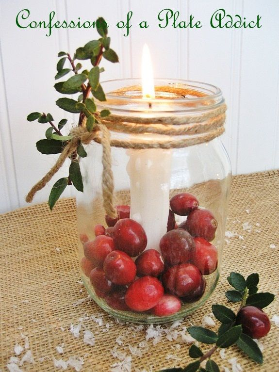 Fun and Easy...Mason Jar Christmas Candles Take a Mason jar, add candles, cranberries and some boxwood sprigs and...taa daa.. a fun and easy addition t...