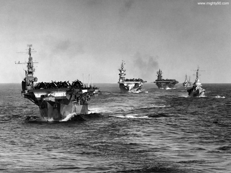 Elements of Task Group 38.2 underway from Ulithi on 30 December 1944. Aircraft carriers are (front to back) INDEPENDENCE CVL-22, HORNET CV-12 and LEXINGTON CV-16. Cruisers at right are SAN JUAN CL-54 followed by CruDiv 17 ships.