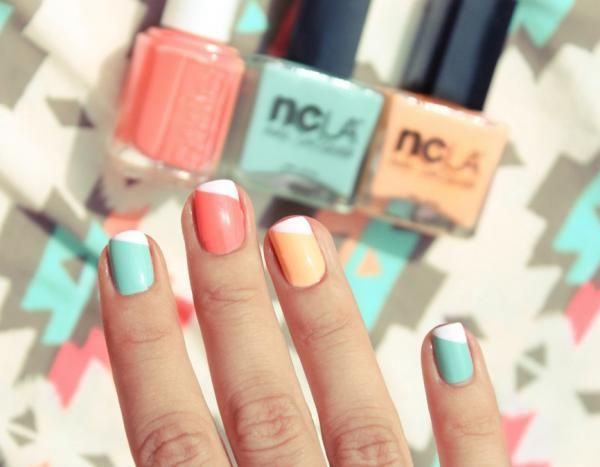 brightly colored nails and diagonal tips