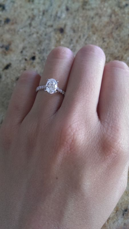 Oval engagement ring with pave band