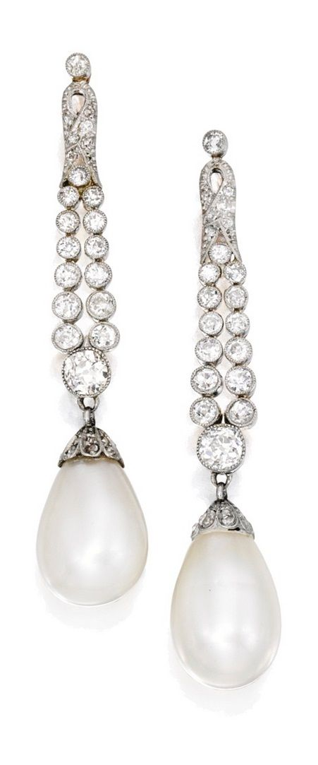 A Pair of Early 20th Century Gold, Platinum, Natural Pearl and Diamond Pendant-Earrings. The two drop-shaped pearls measuring approximately 16.0 by 9.7 to 11.2 mm and 15.0 by 10.8 mm, capped and suspended by rose, single and old European-cut diamonds weighing approximately 3.10 carats. #Early20thCentury #Edwardian #ArtDeco
