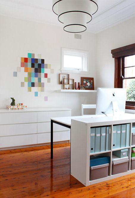 impromptu paint chip mosaic on wall gives the right punch of color. #paintchips