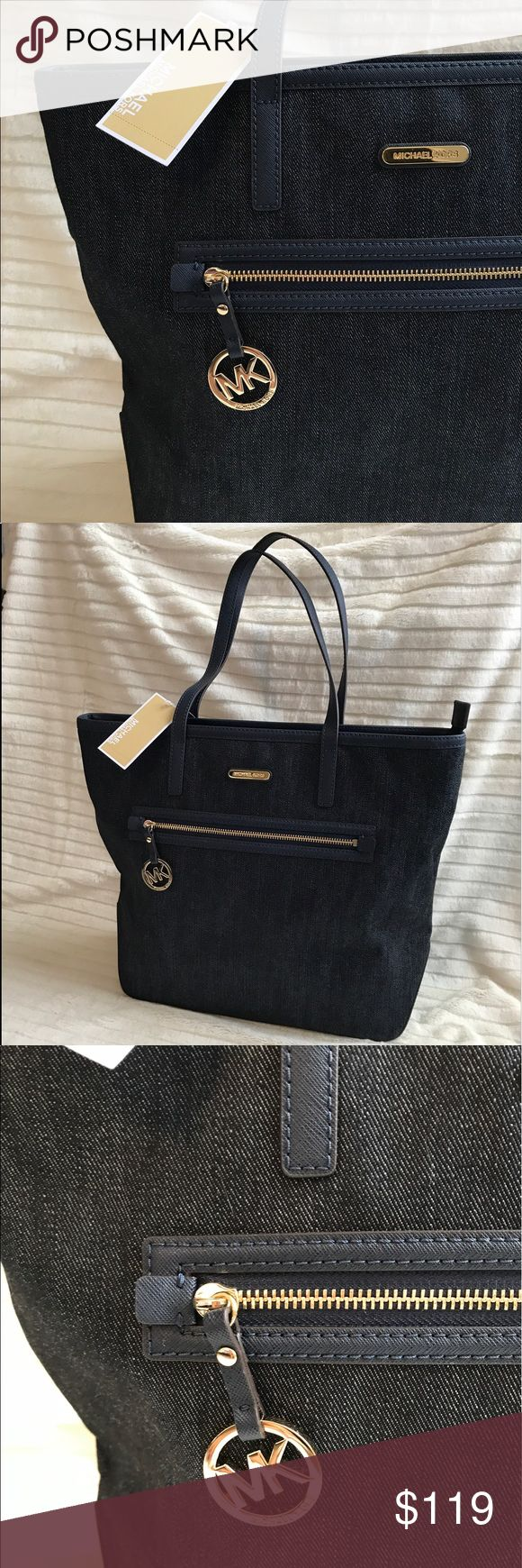 """MICHAEL KORS NWT denim tote/purse New 2017 model! Very roomy and versatile denim and leather shoulder tire/ purse. BRAND NEW WITH TAGS. Aprox. Dimensions are 16"""" wide x 14"""" tall Michael Kors Bags Totes"""