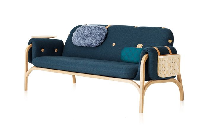 Modern Scandinavian sofa with wooden buttons and attachable cushions and magazine holders