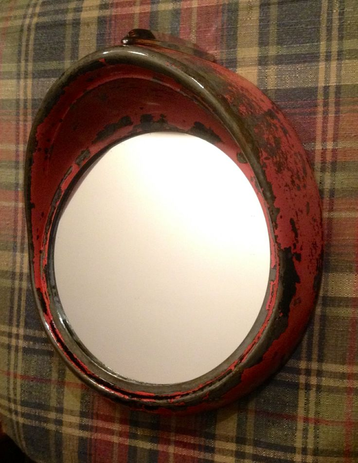 """My own accent mirror made from an as found 1955 Ford headlight bezel. I just applied two coats of spray satin spar varnish to seal the chipping paint and rust and give it a tad of sheen to bring the color out. The glass company cut an 8"""" mirror for $5 and it's glued in with clear HD Power Grab adhesive."""