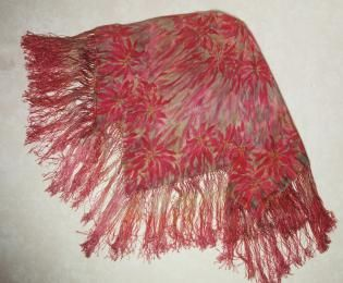 Shawl, silk, hand painted and dyed in poinsettia design, Lucy Dalgarno, Australia, c. 1920-1930 Lucie Gertrude Holdsworth was born on 6 October 1874 at Darlinghurst, Sydney. She married Charles Robert Dalgarno, a bank manager, in about 1900 and was widowed in 1912. Working and exhibiting as L.G. Dalgarno she kept her family by the sale of painted, and batik decorated fabrics, shawls, jackets and other items of clothing and accessories. She also made painted kid jewellery and accessories.