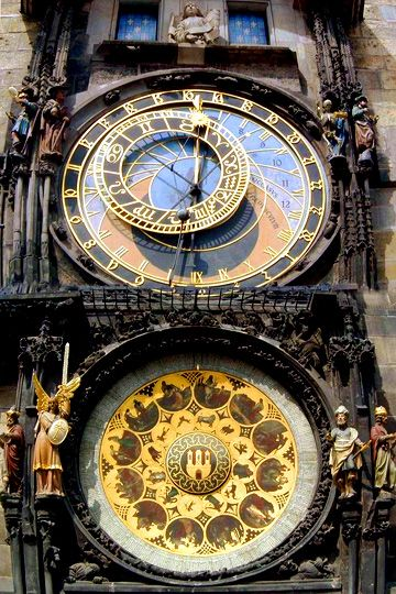 Medieval Astronomical on the Old Town Hall of Prague, 1410. The third oldest of these clocks and the only one still working.  The movable circle inside the outer black hour ring is marked with the signs of the zodiac which indicates the location of the Sun on the ecliptic; the starburst shows the position of the vernal equinox. The moon's movement, sidereal time and changing time of sunset are also depicted (closeup, 2nd of 3 pins).