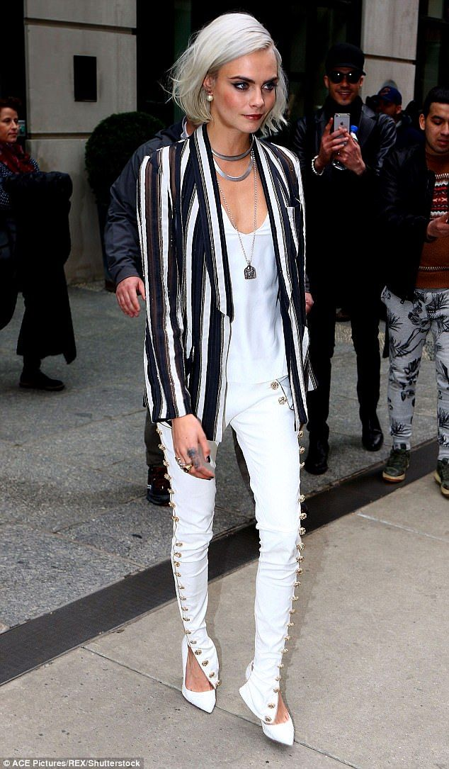 In her element: The 24-year-old teamed the jeans with a killer pair of towering stilettos ...