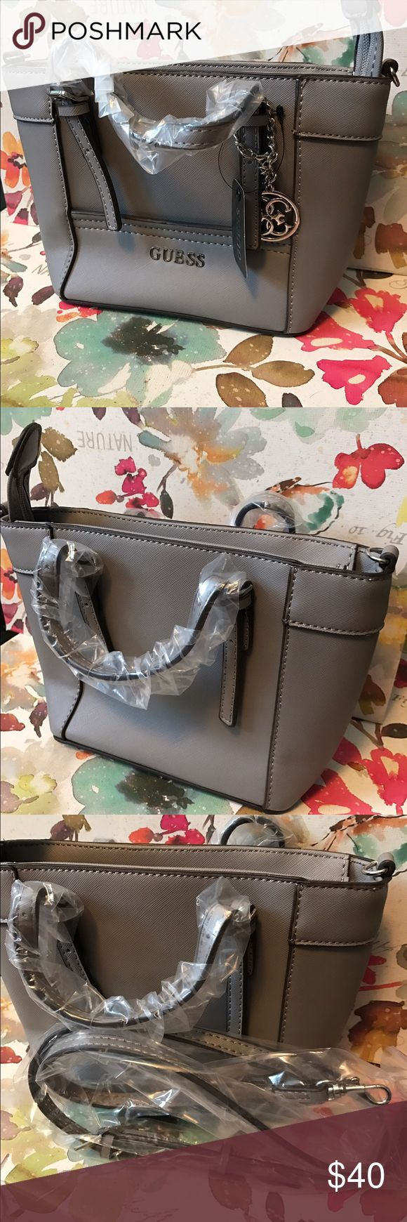 Mini Guess gray purse Brand new, never been used. Originally ordered it thinking it would be bigger because that's what I was looking for. Comes with cross body strap. Guess Bags Mini Bags