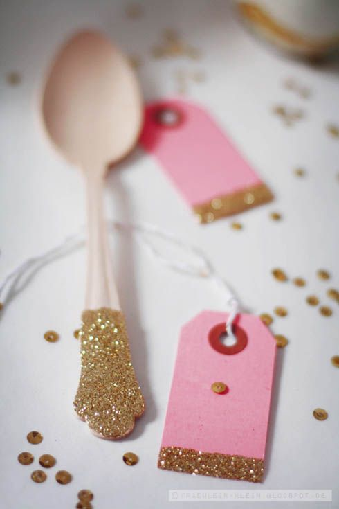 glitter flatware and tag.  dipped or glittered would be a super cute way to dress up plastic utensils at a theme party