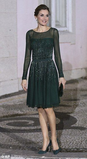 Letizia shows off her trim waist in the fitted green dress...