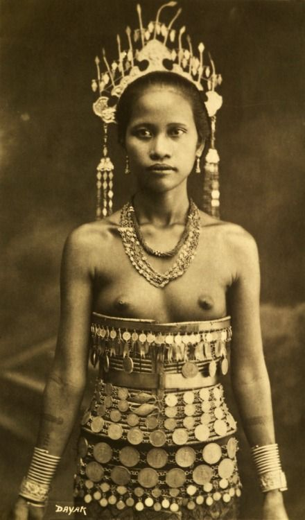 Dayak woman, Indonesia, circa 1900.