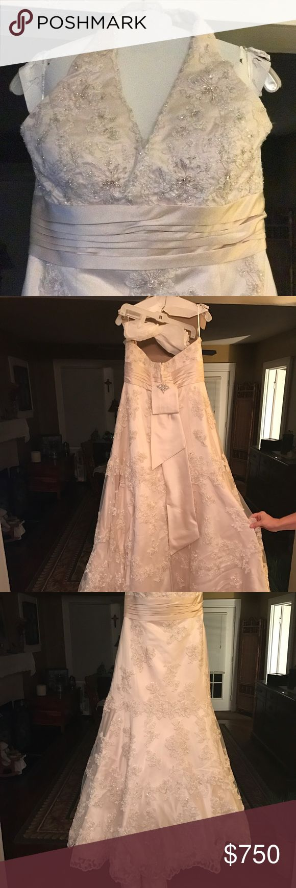Oleg Cassini Wedding dress Never altered Never worn only tried on and neck strap button was moved because it was too loose.  unfortunately doesn't have tags on dress jacket does. The train has a button up for dancing.  Size:16 Color: Ivory/champagne  Paid $1700 for dress alone  Jacket Davids bridal never worn still has tags.  Size: 1x Color: Ivory (matches dress)  Open to all reasonable offers. Oleg Cassini Dresses Wedding