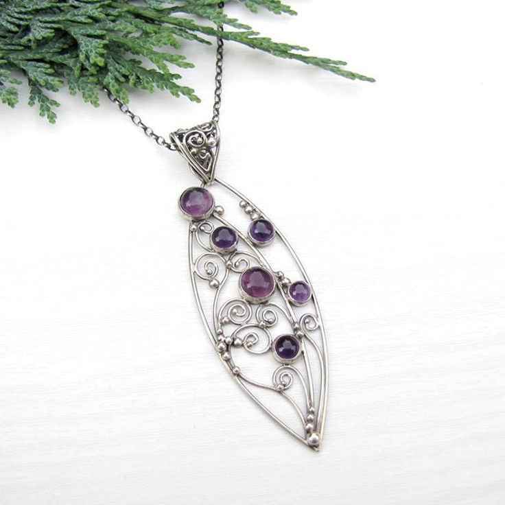 Sterling silver necklace with flourish ornaments. #pendant #silverjewelry #amethyst #uniquejewellery #silverart #silverflowers #filigree