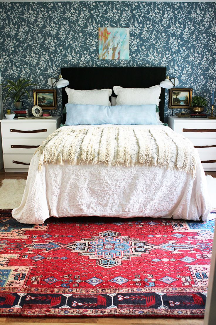 Colorful, bohemian, eclectic master bedroom design with red persian rug and floral wallpaper #bedroom