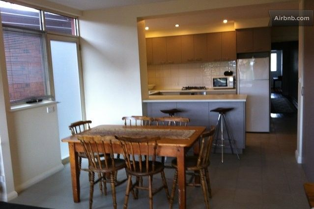 Kitchen and spacious dining area has access to the courtyard at the rear of the house.