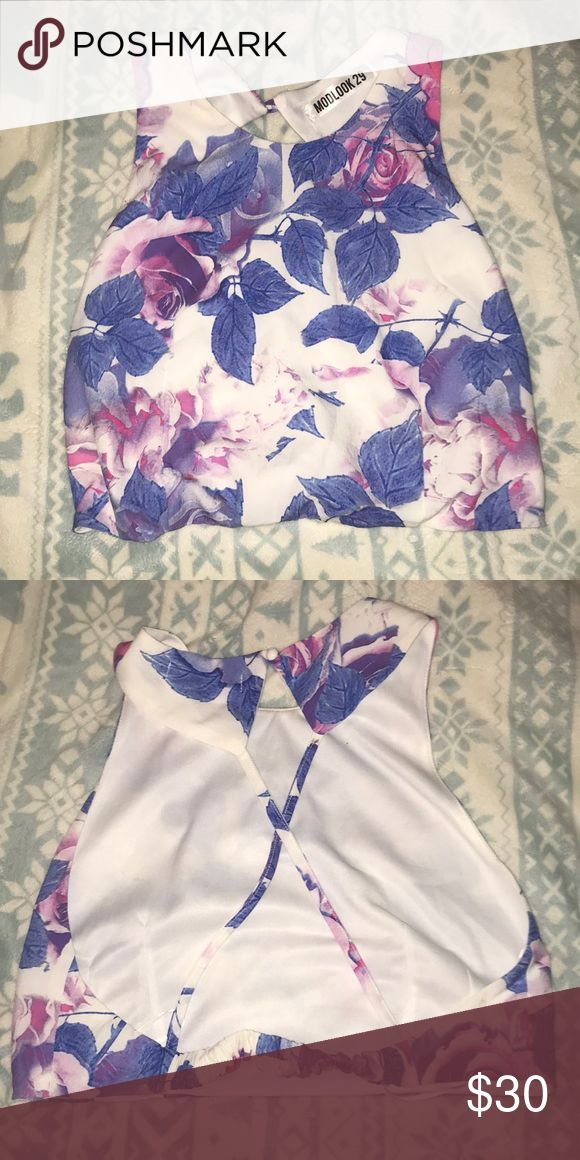 Elegant floral water color crop top Tried on from a local boutique but never get a chance to wear it. It is so elegant and has a beautiful back to it Tops Crop Tops