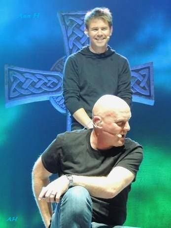 Can you tell Neil just messed with George's microphone? Look at that evil smile!.....love him..