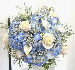 blue winter wedding flowers bouquet---like more variety in flower type, still white and blue