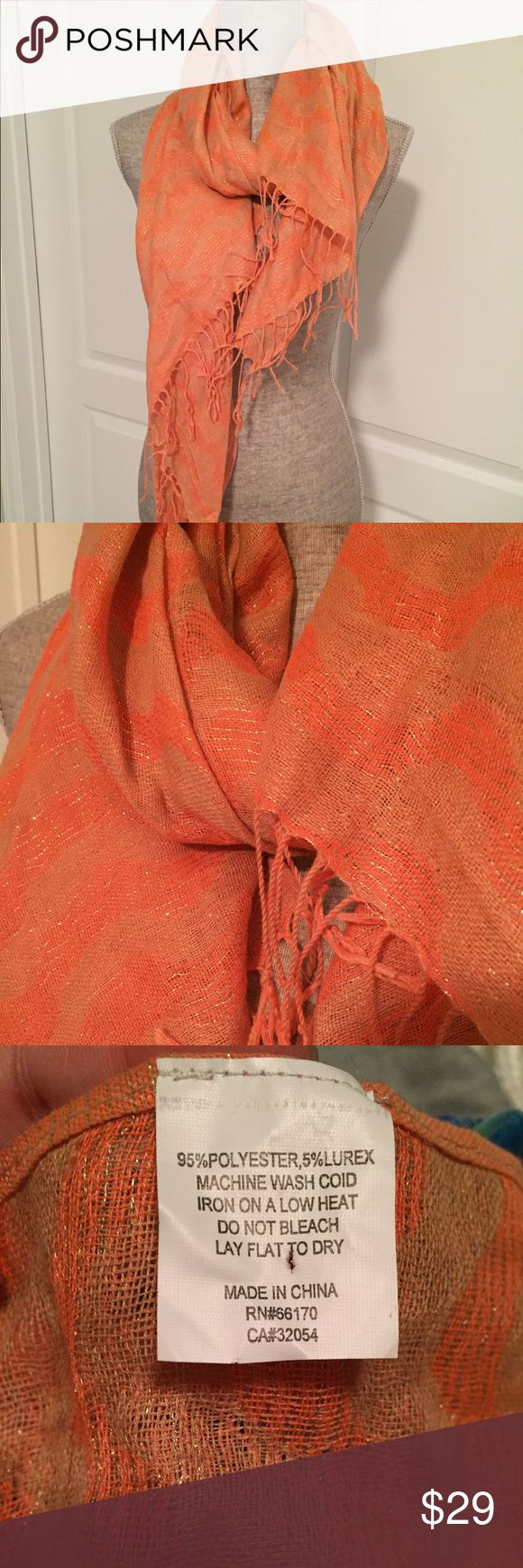 Anthropologie Scarf Orangey-coral scarf with some shimmer threads.  Round shaped pull, pictured. Anthropologie Accessories Scarves & Wraps