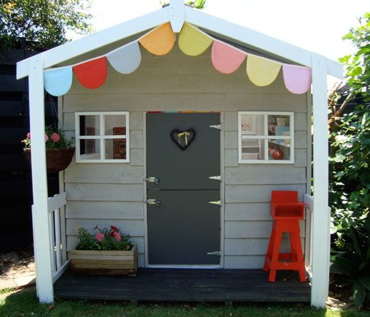 Last year we flipped for the dollhouse that Megan decorated for her girls, and this playhouse reflects that same great taste and style: supersized.