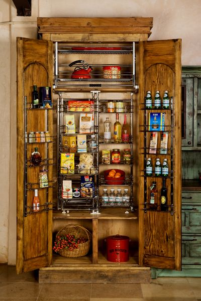 Custom Built Wooden Pantry Hand Carved Reclaimed Wood Doors Open To Reveal A Highly Functionable Kitchen Revolving Wir