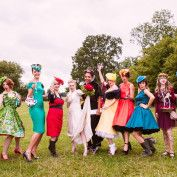 Alice in Wonderland Wedding. The bridesmaids are all in fancy dress with bold colours and handmade fascinators - Anna Pumer Photography