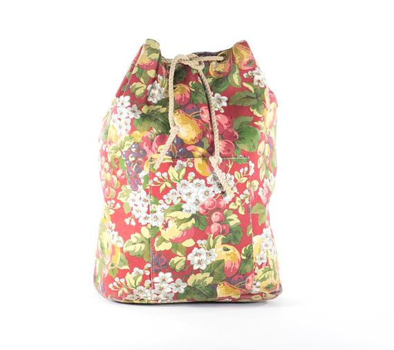 This is a great apple blossom floral canvas rucksack backpack travel, school bag. With adjustable cinch top and rope shoulder straps, large