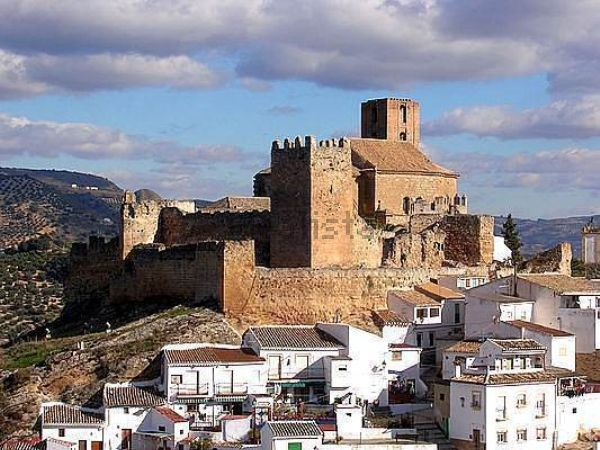 CASTLES OF SPAIN - Iznájar Castle, lies in the center of the village with the same name, surrounded by the Iznájar reservoir, in the province of Córdoba. Iznájar Castle was built in the 8th century by the Umayyads, most probably on the ruins of an earlier fortification of Visigothic or Roman origin. In 1434 Iznájar Castle was finally taken for the Christians by troops led by Pedro Fernández de Córdoba after a hard battle with the Moors who were guarding the castle.